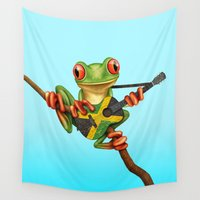 jamaica Wall Tapestries featuring Tree Frog Playing Acoustic Guitar with Flag of Jamaica by Jeff Bartels