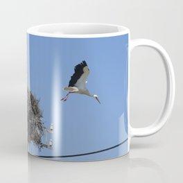 A storks' nest on a telegraph pole Coffee Mug