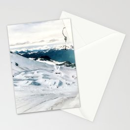 Snowy life on slope under T-bar lifts Stationery Cards
