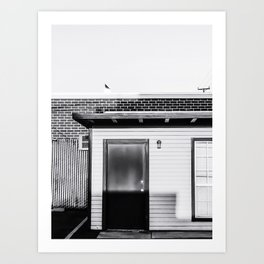 wood building with brick building background in black and white Art Print