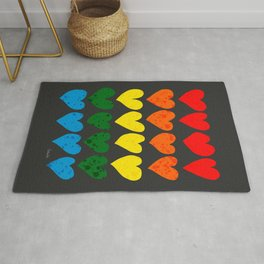 Rainbow hearts with black background Rug