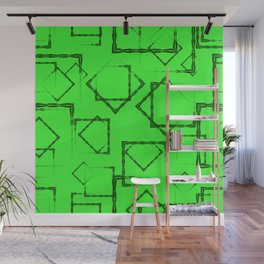 Green rhombuses and squares in the intersection on a light green background. Wall Mural