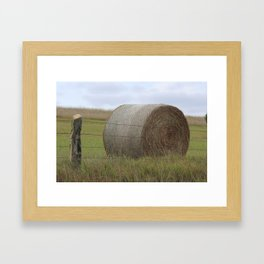 Kansas Hay Bale in a field with a fence Framed Art Print