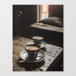 Warm tones of cafe with 2 cups of espresso coffee in hand-painted blue mugs Canvas Print
