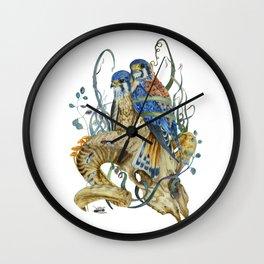 Kestrel and skulls Wall Clock