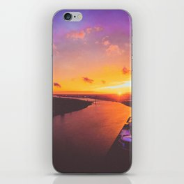 fiery sunset over the Detroit River iPhone Skin