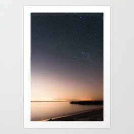 Beautiful starry scene at the coast of 'Colonia, Uruguay'. Long exposure with light pollution. Art Print