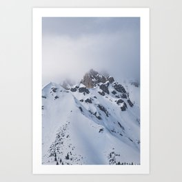 Snow covered mountain top with clouds in Austria Art Print