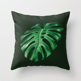 Vivid green monstera leaf on dark background Throw Pillow