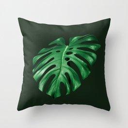 Vivid green monstera leaf on dark background Throw Pillow