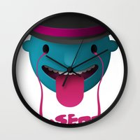 cookie Wall Clocks featuring Insert Cookie by mrbiscuit