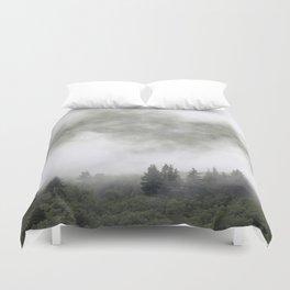 Pine trees in mist. Scotland. Duvet Cover
