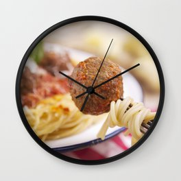 Spaghetti and meatball on a fork, plate in the background Wall Clock