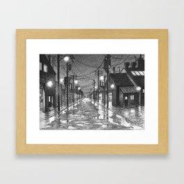 Raining on industrial street Framed Art Print