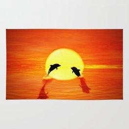 dolphin sunset jump Rug