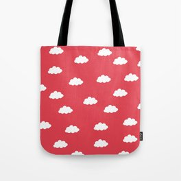 White clouds in red background Tote Bag