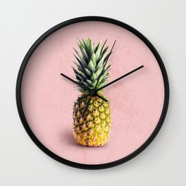 Pineapple on pink background Wall Clock