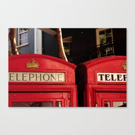 Approaching the roof of two typical English telephone booths. Canvas Print