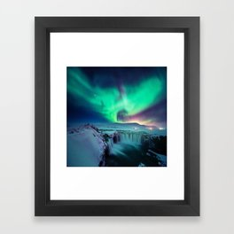 Aurora Borealis Over A Waterfall Framed Art Print
