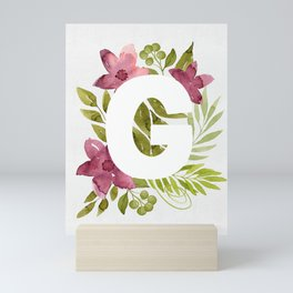 Monogram G with red waercolor flowers and green leaves. Floral letter G. Botanical illustration. Mini Art Print