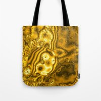 saturn Tote Bags featuring Saturn by Brian Raggatt