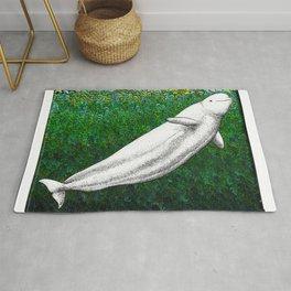 Beautiful beluga whale in the ocean Rug