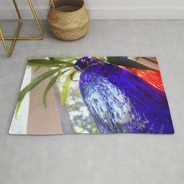 Blue glass and plant Rug