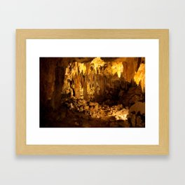 Cave with stalagmites and stalactites, a study of light and darkness Framed Art Print