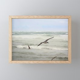 Seagulls flying over rough sea Framed Mini Art Print