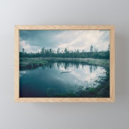 The sky with clouds, which is reflected in the waters of the river on which floats Board Framed Mini Art Print