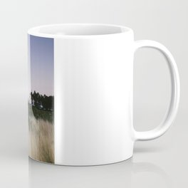 Moon and twilight sky over open area of felled forestry land. Norfolk, UK Coffee Mug