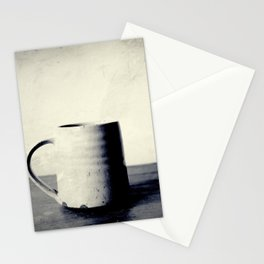 Cup of coffee on a table Stationery Cards