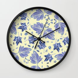 Autumn leaves in light yellow and blue Wall Clock