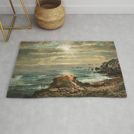 Sunlight through the Clouds over a Rocky Coast by Edmond Darch Lewis Rug