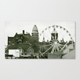 Clouds and roofs and Ferris wheel Canvas Print