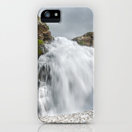 Summer landscape: mountain waterfall falling into snowfield iPhone Case