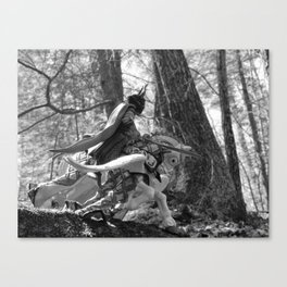Knight riding through the forest Canvas Print