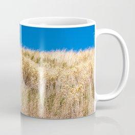 Dry grass meadow and blue sky Coffee Mug