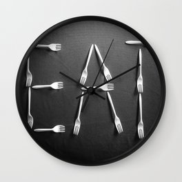 EAT alphabet with plastic forks in black and white Wall Clock