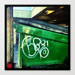 Green graffiti dumpster. Canvas Print
