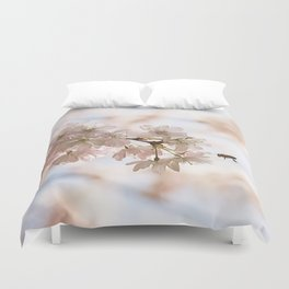 Bee and cherry branches against the blue sky Duvet Cover