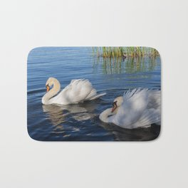Swan Art. Two Beautiful Swans with Fluffy Wings on the Lake Bath Mat