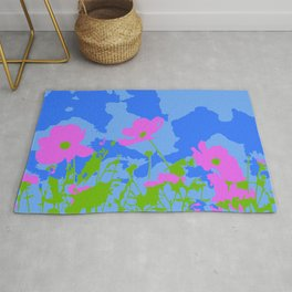 Pink Flowers Among The Blue Rug