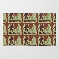 bigfoot Area & Throw Rugs featuring Bigfoot Believe by Heather Green