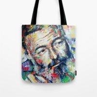 hemingway Tote Bags featuring Ernest Hemingway by Marta Zawadzka