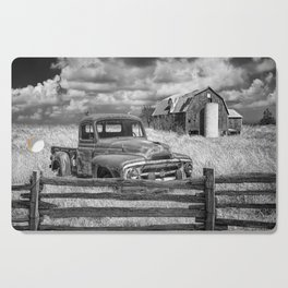 Black and White of Rusted International Harvester Pickup Truck behind wooden fence with Red Barn in Cutting Board