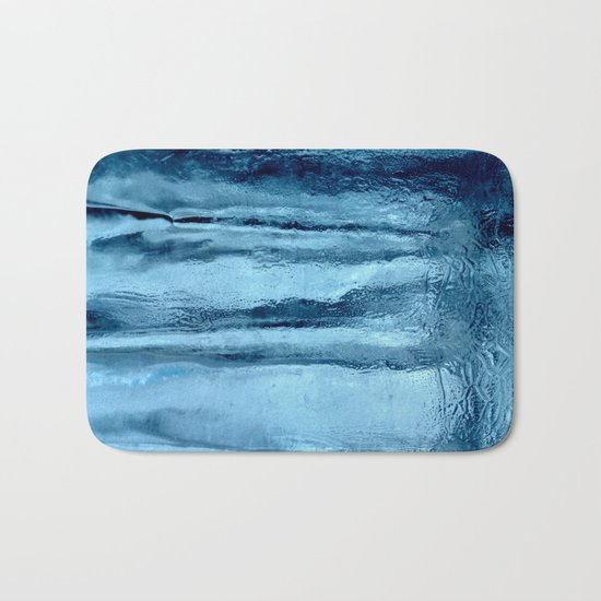 Ice with blue tonnes in a cold winter Bath Mat