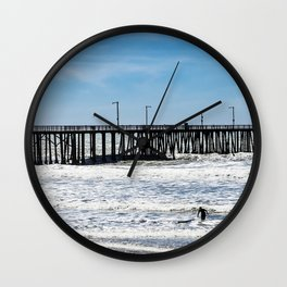 A Panoramic View Of Pismo Beach Pier, Surfers And Ocean Wall Clock