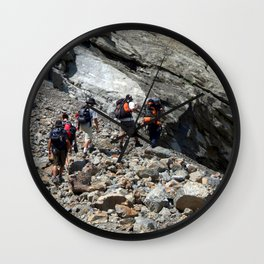 Trekkers Climbing over Landslide Wall Clock