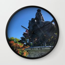 Statue Amongst the Changing Colors Wall Clock